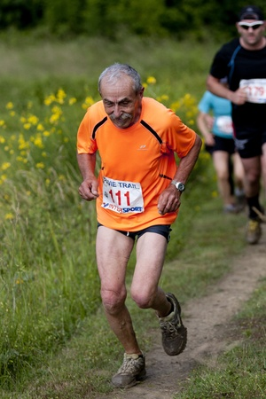 PAVIE, FRANCE - JUNE 23: Elderly runner at the Trail of Pavie, on June 23, 2013, in Pavie, France.