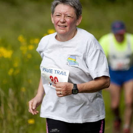 PAVIE, FRANCE - JUNE 23: Old female runner at the Trail of Pavie, on June 23, 2013, in Pavie, France.