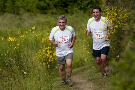 PAVIE, FRANCE - JUNE 23:Two brothers, Alain and Jean Labant,  at the Trail of Pavie, on June 23, 2013, in Pavie, France. All around them gorse in full bloom.
