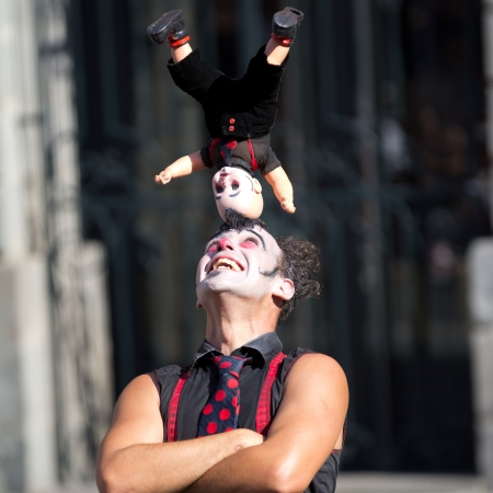 AURILLAC, FRANCE - AUGUST 23  a dool on the head of a clown as part of the Aurillac International Street Theater Festival,show by the Company Cartoon Toylette ,on august 23, 2013, in Aurillac,France  Editorial
