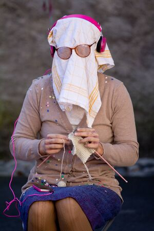 arbre: AURILLAC, FRANCE - AUGUST 21  a blind elderly woman is knitting as part of the Aurillac International Street Theater Festival, Company L arbre � vache ,on august 21, 2013, in Aurillac,France  Editorial