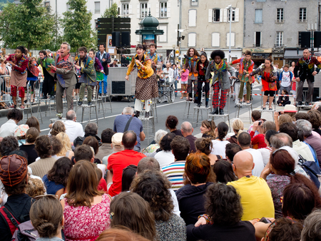 cantal: AURILLAC, FRANCE - AUGUST 23  actors perched on bar stools in the middle of the crowd,as part of the Aurillac International Street Theater Festival, Cie Oposito,on august 23, 2013, in Aurillac,France  Editorial