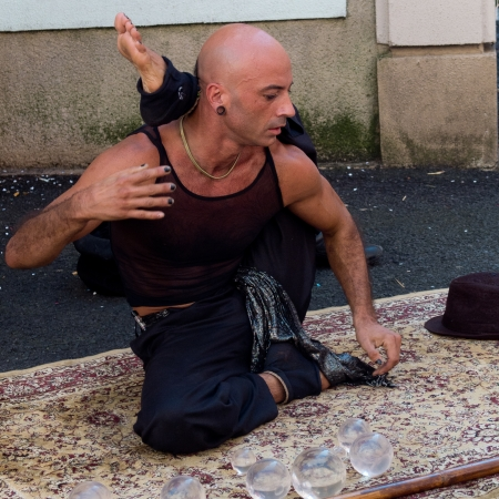 supple: AURILLAC, FRANCE - AUGUST 23  Portrait of a very supple street performer, named Jyoti, as part of the Aurillac International Street Theater Festival, on august 23, 2013, in Aurillac,France