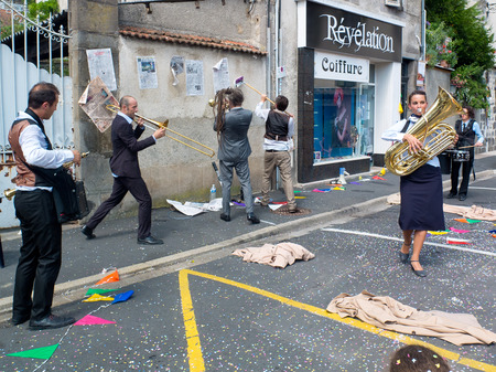 AURILLAC, FRANCE - AUGUST 23  musicians playing in the street, as part of the Aurillac International Street Theater Festival, cie Rhinofanpharyngite,on august 23, 2013, in Aurillac,France