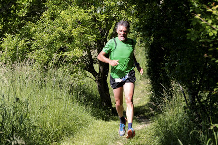 gascony: PAVIE, FRANCE - MAY 18  Portrait of a motived runner at the Trail of Pavie, on May 18, 2014, in Pavie, France