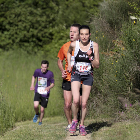 gascony:  PAVIE, FRANCE - MAY 18   Runner who breathes hardly behind a woman who leads the group at the Trail of Pavie, on May 18, 2014, in Pavie, France   Editorial