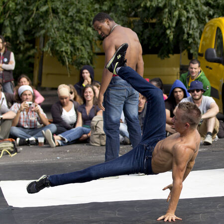 aurillac: AURILLAC, FRANCE-AUGUST 25: a young and strong breakdancer play in the street  as part of the Aurillac International Street Theater Festival, cie Bakhus 24,on august 25, 2014, in Aurillac,France.