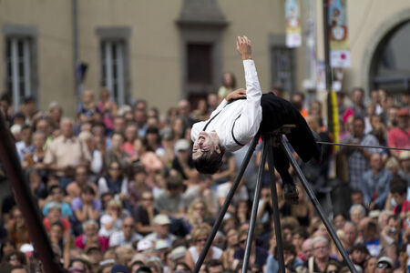 balancing act: AURILLAC, FRANCE-AUGUST 22: balancing act in front of a big crowd as part of the Aurillac International Street Theater Festival, cie teatro del silencio ,on august 22, 2014, in Aurillac,France. Editorial