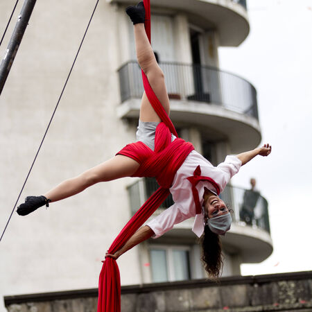 aurillac: AURILLAC, FRANCE-AUGUST 22: a young acrobat is hung upside down as share of the Aurillac International Street Theater Festival, cie teatro del silencio there august 22, 2014 in Aurillac, France. Editorial