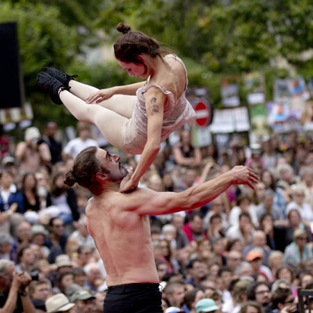 high torque: AURILLAC, FRANCE-AUGUST 22: a man throws a young woman high in the air as share of the Aurillac International Street Theater Festival, cie teatro del silencio there august 22, 2014 in Aurillac, France.