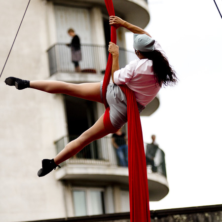hung: AURILLAC, FRANCE-AUGUST 22: Back view of year acrobat hung legacy apart as share of the Aurillac International Street Theater Festival, cie teatro del silencio there august 22, 2014 in Aurillac, France. Editorial