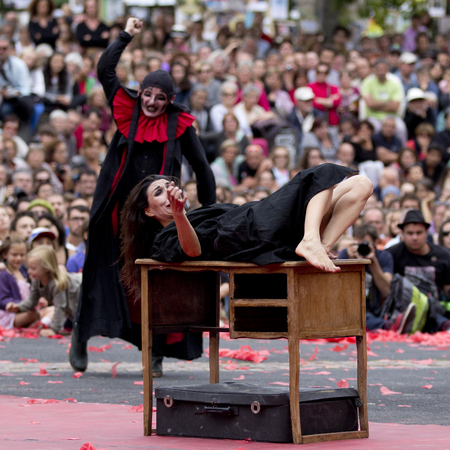 terrorized: AURILLAC, FRANCE-AUGUST 22: a woman is attacked This scared by a man as share of the Aurillac International Street Theater Festival, cie teatro del silencio there august 22, 2014 in Aurillac, France.