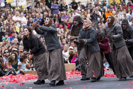 AURILLAC, FRANCE, AUGUST 22: Famine with Russian women crying for help as share of the Aurillac International Street Theater Festival, cie teatro del silencio, there august 22, 2014 in Aurillac, France.