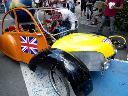aurillac: AURILLAC, FRANCE, AUGUST 21: An artist HAS built a fake show as 2CV For His hand of the Aurillac International Street Theater Festival, on august 21, 2014 in Aurillac, France.