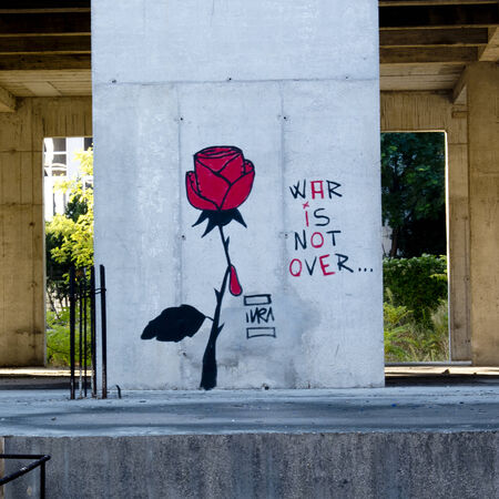 There is a red tear, only one. It rolls from a rose.It is painted like a prickle on a wall of Mostar to tell que le war is not over in Bosnia. Stock Photo