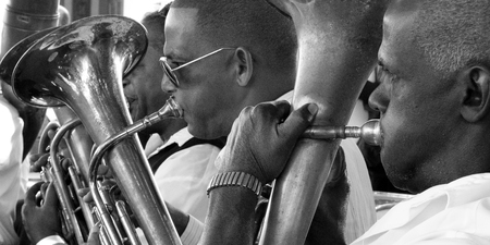 inflate: CIENFUEGOS, CUBA, DECEMBER 9: musicians of a marching band inflate Their cheeks to blow In Their instruments include december 9, 2014 in Cienfuegos, Cuba. Editorial