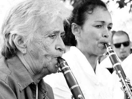 fanfare: CIENFUEGOS, CUBA, DECEMBER 9: An old woman and Reviews Reviews Reviews Reviews another year musician play music in a square, we december 9, 2014 in Cienfuegos, Cuba. Editorial