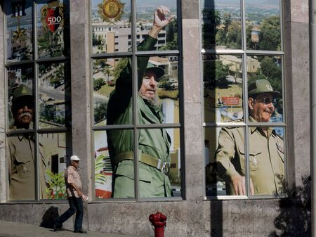 SANTIAGO DE CUBA, CUBA - NOVEMBER 29: Portrait of Fidel Castro and his brother Raul in the center of the town, on november 29, 2014, in Santiago de Cuba, Cuba.