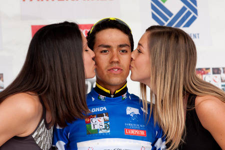 martinez: AUCH FRANCE JUNE 18: The kiss of two cute young hostesses to Daniel Martinez Colombian racer on the podium of the first course of the Route du Sud on June 18 2015 in Auch France.