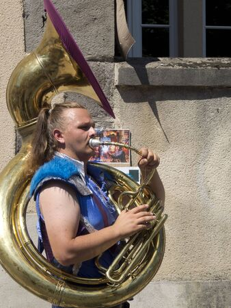 AURILLAC, FRANCE - AUGUST 19: Man playing the tuba in the street as part of the Aurillac International Street Theater Festival, on august 19, 2015, in Aurillac,France Editorial