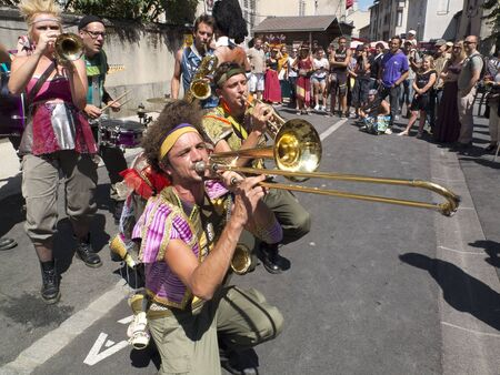 AURILLAC, FRANCE - AUGUST 19: Brass band playing in the street, as part of the Aurillac International Street Theater Festival, on august 19, 2015, in Aurillac,France. Editorial