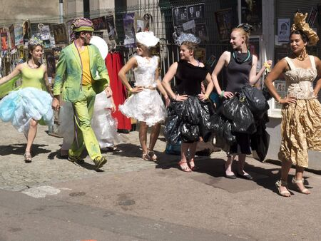 parody: AURILLAC, FRANCE - AUGUST 19: some artists organise a fashion show parody in the street, as part of the Aurillac International Street Festival, on august 19, 2015, in Aurillac, France.