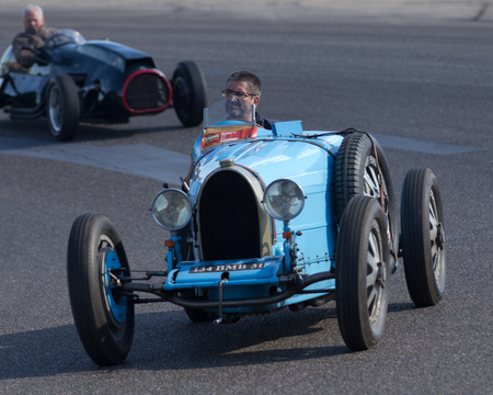 Nogaro, France - October 9, 2016: Very old race car going fast on a motor-racing circuit during the Classic Festival. Editorial