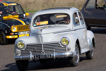 Nogaro, France - October 9, 2016: Old Peugeot 203 going fast on a motor-racing circuit during the Classic Festival.