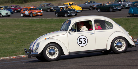 Nogaro, France - October 9, 2016: Old White Coccinelle going fast on a motor-racing circuit during the Classic Festival. Editorial