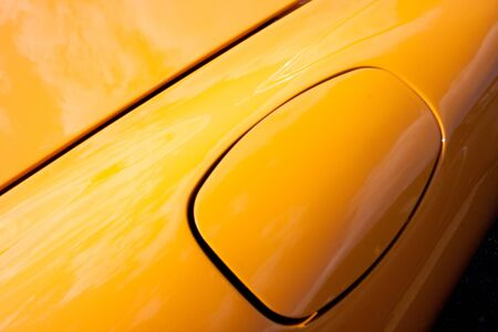 Body part of a yellow car.