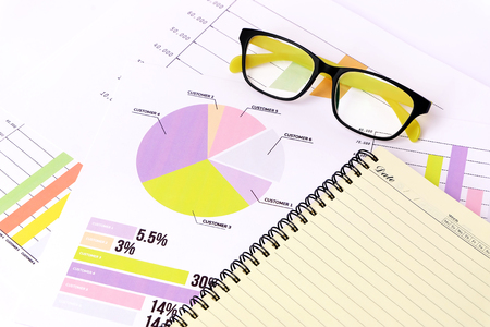money management: business charts graphs information and reports with glasses