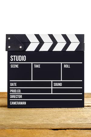cinta pelicula: Película pizarra película en mesa de madera, aislante fondo Foto de archivo