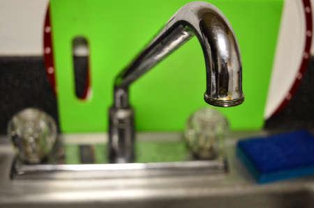 Closeup of a kitchen sink faucet