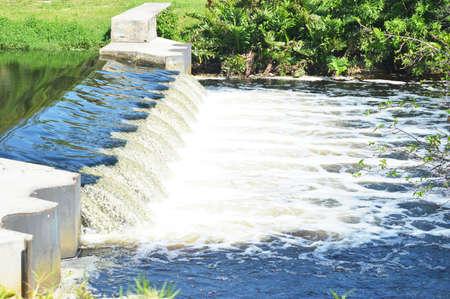 rushing water: Florida Canal Waterfall Stock Photo