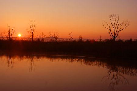 horison: Sunrise over the water. Stock Photo
