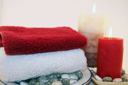 A relaxing setting of candles and towels ready for a relaxing bath or soothing massage. photo