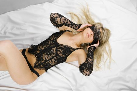 Beautiful blonde sex in bed Stock Photo