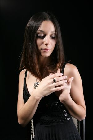 coulomb: Beautiful girl in a black dress with an ornament
