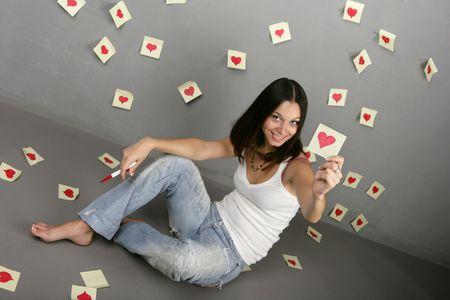 causal: Girl drawing around the heart shape