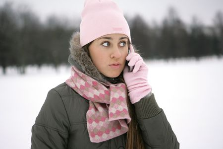 Winter girl on the phone  photo