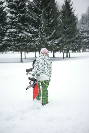The girl goes to snowboard ride  photo