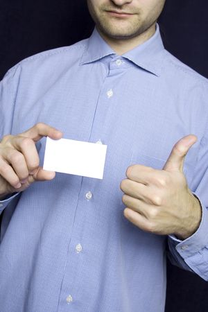 Business man holding blank card. OK  photo
