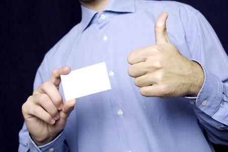 Business man holding blank card. OK  photo