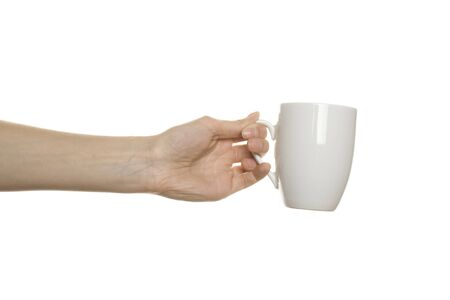 White cup in the female hands photo