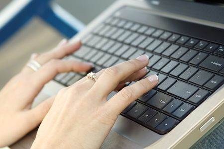 Close up of a hand typing on laptop keyboard Stock Photo - 7167818