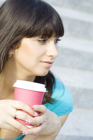 Female in a park drinking coffee  photo