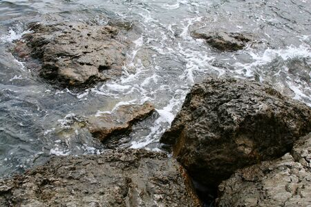 Black Sea coast, the waves beating against the rocks photo