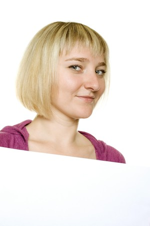 Young woman leaning on billboard photo