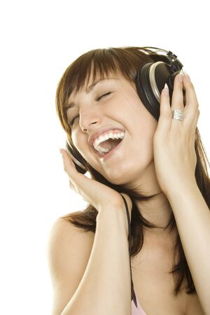 Woman listening to music and singing Stock Photo - 7560572