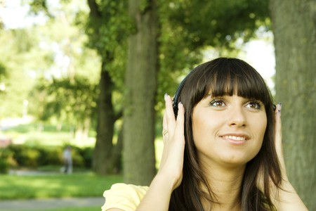Young woman listening to music  photo